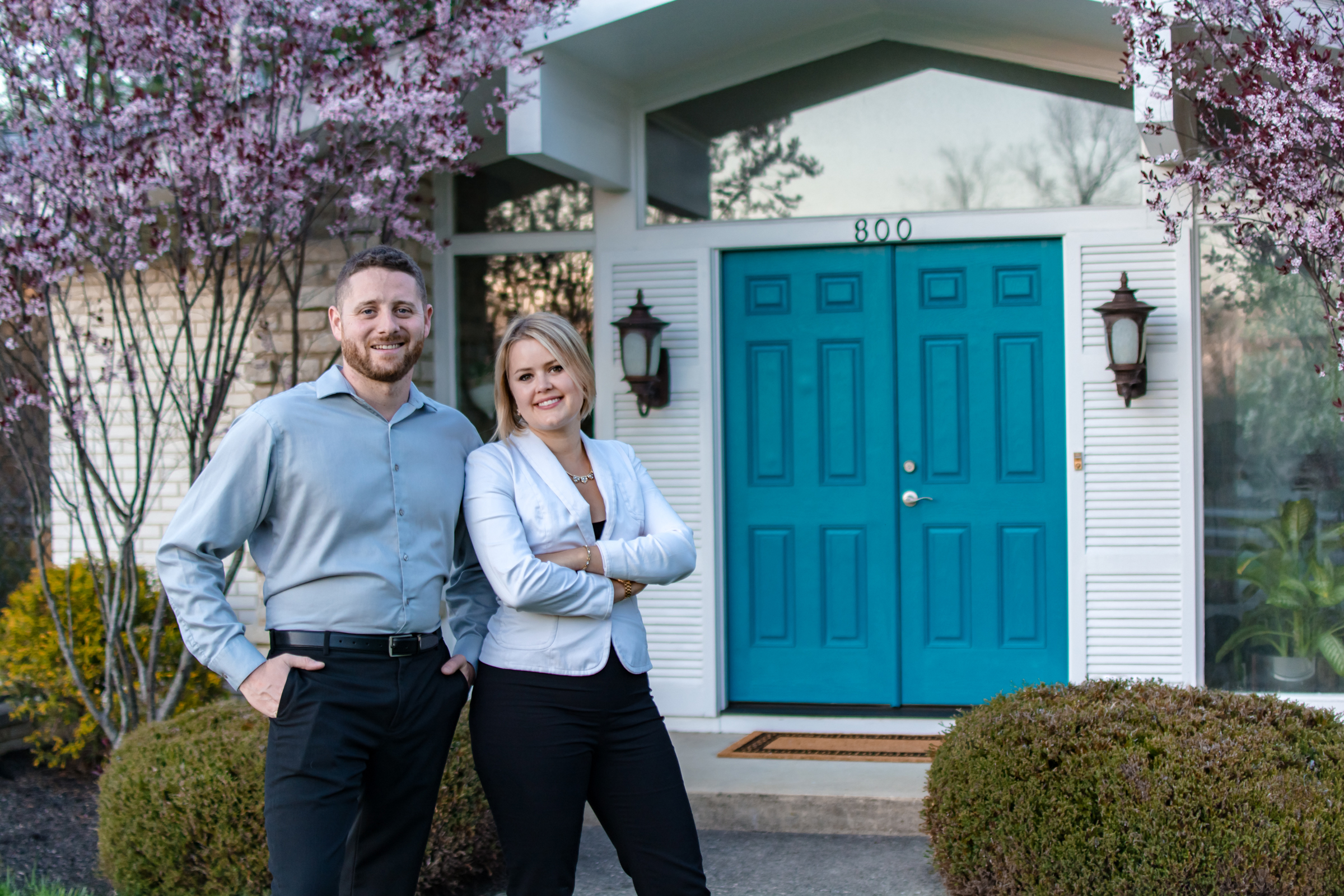 Real Estate Agents in front of Flat Rate Listed Home